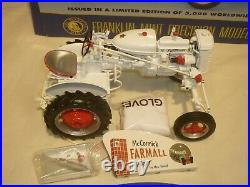 A Franklin mint of a scale model of a International Harvester super A Tractor