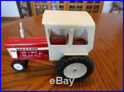 Vintage 1968 ERTL 116 Farmall 560 Tractor with Cab, Stock No. 409, Narrow Front
